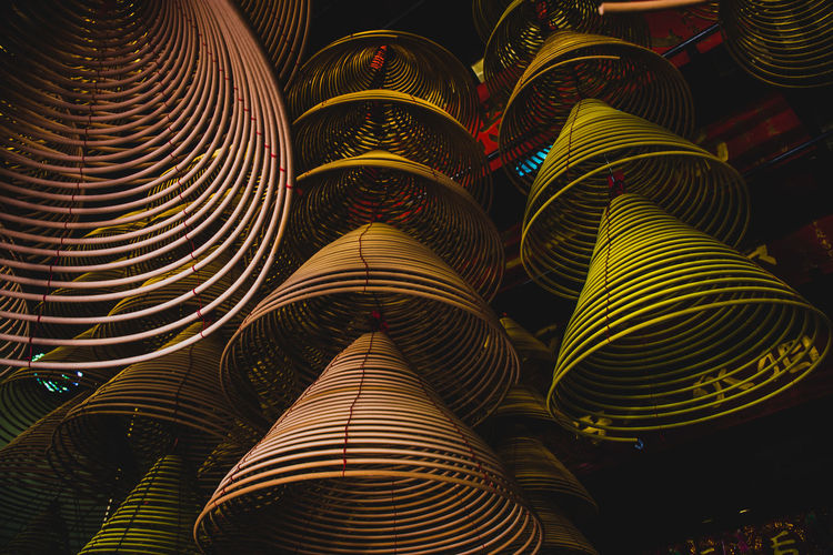 Low angle view of incense stick hanging