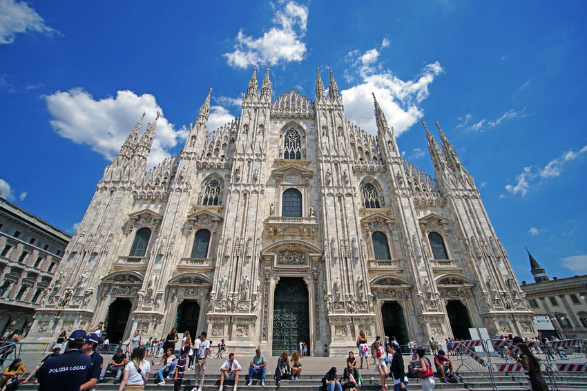 Milan Duomo in June 2018. Italy Cathedral Duomo Milan Sitting The Traveler - 2018 EyeEm Awards Architecture Belief Blue Sky Building Building Exterior Built Structure Crowd Group Of People Large Group Of People Nature Outdoors Place Of Worship Real People Religion Sky Spirituality Tourism Travel Travel Destinations Women