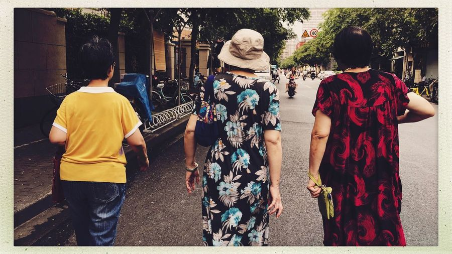 Shanghai Friendship Streetphotography Real People Transfer Print Rear View Auto Post Production Filter Women City Leisure Activity Adult Lifestyles Clothing People Group Of People Street Togetherness Walking Three Quarter Length Casual Clothing Day Architecture Outdoors