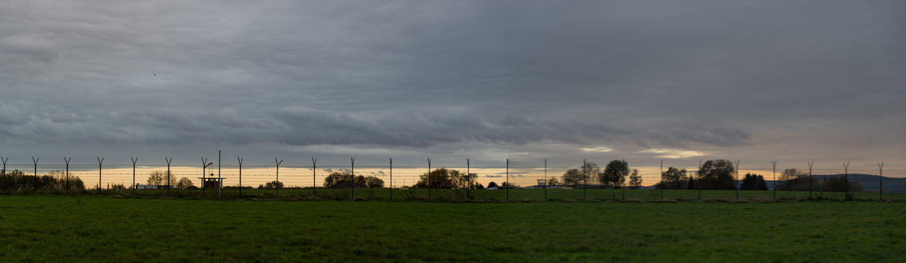 Evening Sky Dramatic Sky Nature Panorama Tranquility Around Sunset Beauty In Nature Clouds And Sky Evening Evening Sky Fence No People Outdoors Sunset