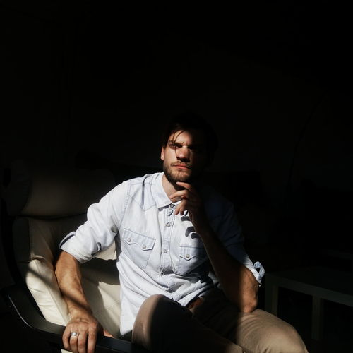 Sunlight Falling On Thoughtful Man On Chair