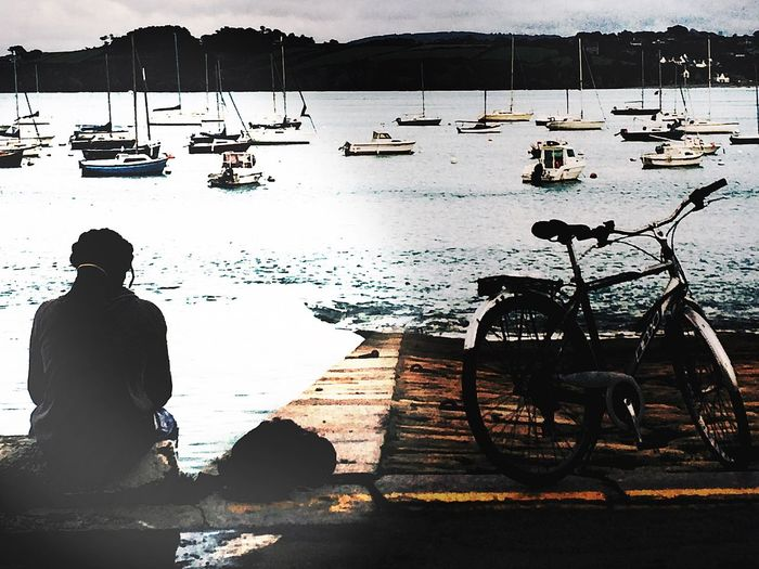 Watching the boats Waterfront Water Sunshine Sun Boat Bicycle Sitting Man Dreadlocks Port Boat