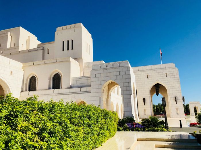 Blue Sky Sunlit Opera Oman Stunning Building Oman Beautiful Architecture Modern Architecture Opera Oman Opera House Muscat Arabian Architecture Architecture Built Structure Arch Building Exterior Clear Sky Day Tree Plant Blue Outdoors No People