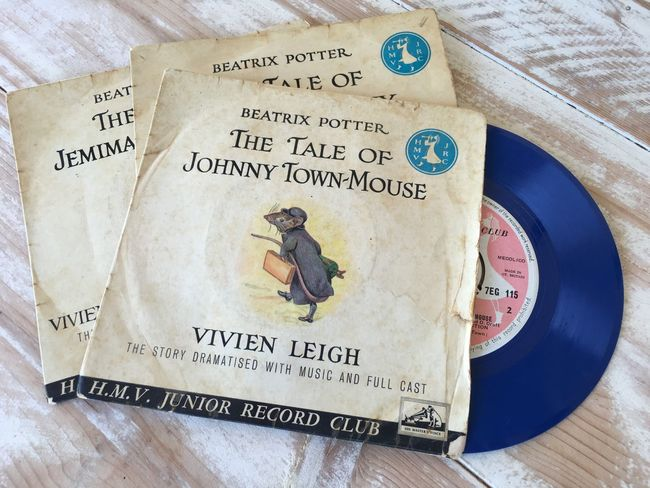 Collection of 45rpm Beatrix Potter stories on blue vinyl, read by Vivien Leigh 45rpm Audio Beatrix Potter Childhood Close-up Day HMV Junior Record Club Indoors  Memories No People Old Records Records Records Collection Story Time Throwback Thursday Vinyl Records Vivien Leigh Lieblingsteil