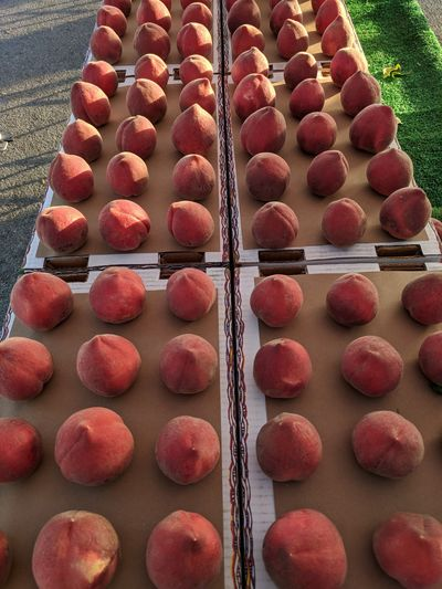 white peaches at the farmers market.. Peaches🍑 Close-up Sweet Food Display