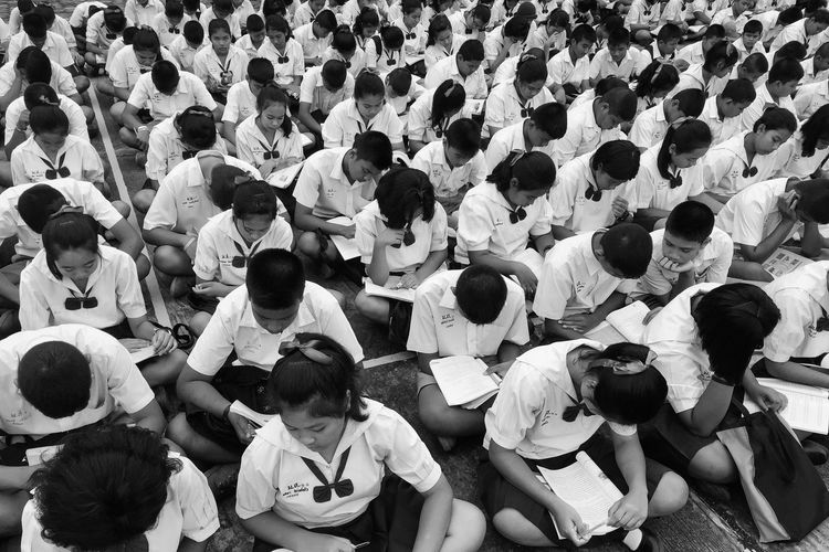Reading a book School Thai Learning Reading Read Student Group Of People Large Group Of People Real People Crowd High Angle View Child Women Day Childhood Religion