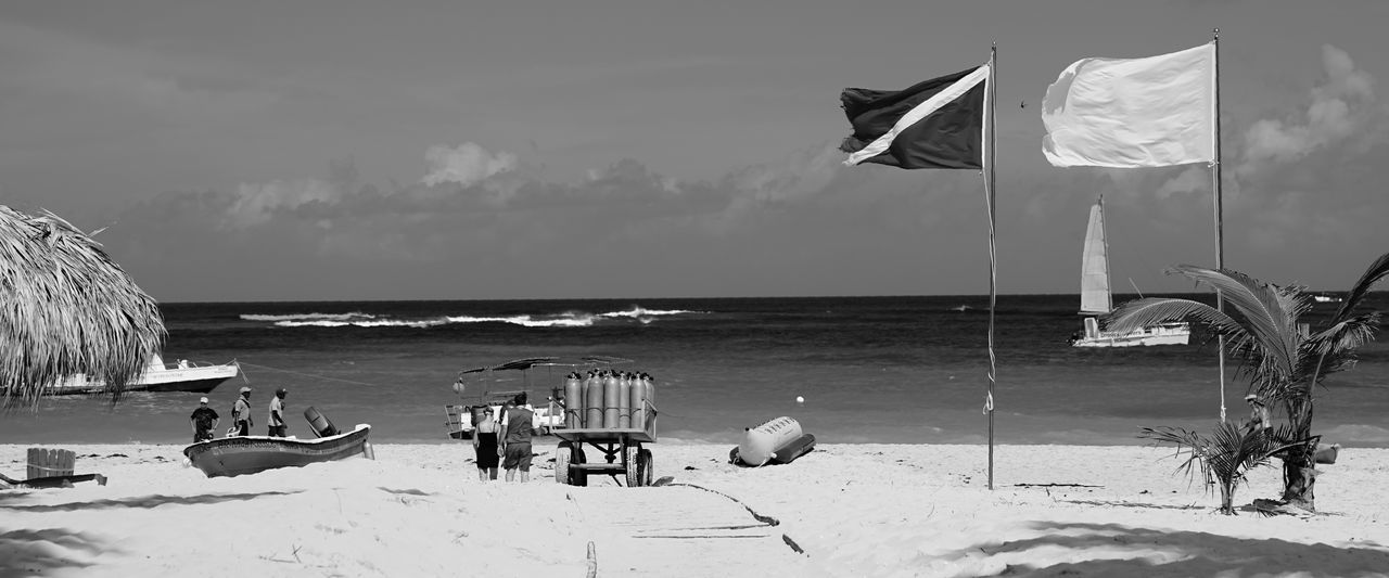 dive shop by the ocean Blackandwhite Monochrome Reflection Sun Trees Focus Boats Waves Horizon Caribbean Dominican Republic Punta Cana Clouds Resort Vacation Peaceful Quiet Heaven Shadow Contrast Close Up Shore Sony Sonya7II Flag Sea Beach Water Patriotism Sky Horizon Over Water Nature Outdoors Day Scenics