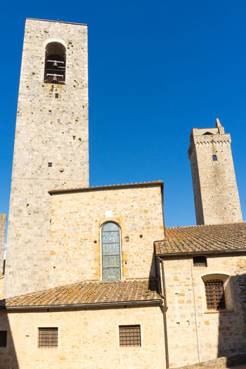 The towers in San Giminano, Italy San Gimignano Tuscany Architecture Bell Tower - Tower Blue Building Building Exterior Built Structure Clear Sky Day History Italy Low Angle View Nature No People Old Outdoors Place Of Worship Religion Sky Sunlight The Past Tower Travel Destinations