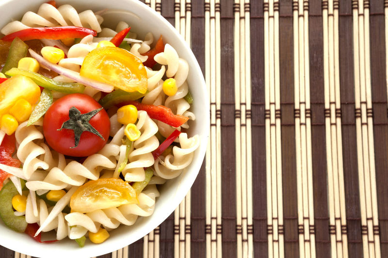 Fusilli salad with yellow and red cherry tomatoes, red and green pepper, sliced onion and corn grains bowl. Lateral view. Fusilli Natural Light Salad Spanish Onion Cherry Tomatoes Corn Grain Directly Above Food Food And Drink Freshness Fusilli Pasta Fusilli Salad Green Peppers Healthy Eating Italian Food No People Pasta Salad Red Peppers Striped Background Studio Photography Summer Salad Tomato Vegetable Yellow Cherry Tomato