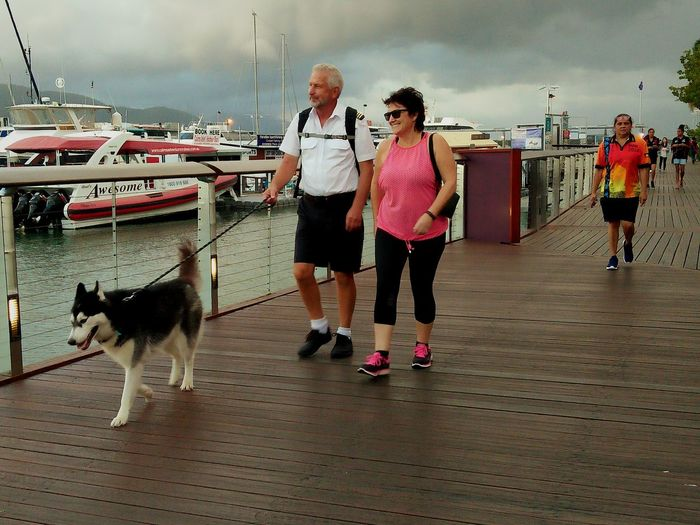 This is so beautiful photography of couple people with siberian husky for exercise in afternoon everyday. The Following Siberian Husky Couple Walking Marina Marina Bay Boats⛵️ Boats And Water Boats And Clouds Boats Boats Boats People Are People People Walking  People Portrait Dog❤ Footpath People Smile:) Beautiful View Marina Walk Awesome Photography Tourists Relaxation People Tourist