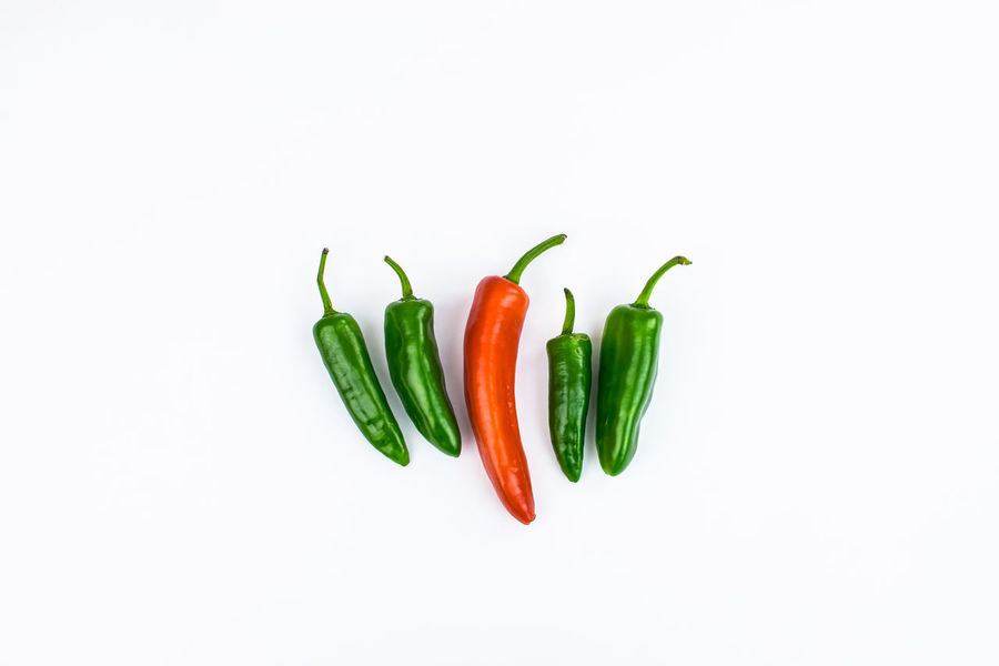 A small scene created using Chilli peppers Capsicum Chillis Finger Chilli Food Freshness Green Chili Pepper Green Color Healthy Eating Pepper Spice Studio Shot Vegetable White Background