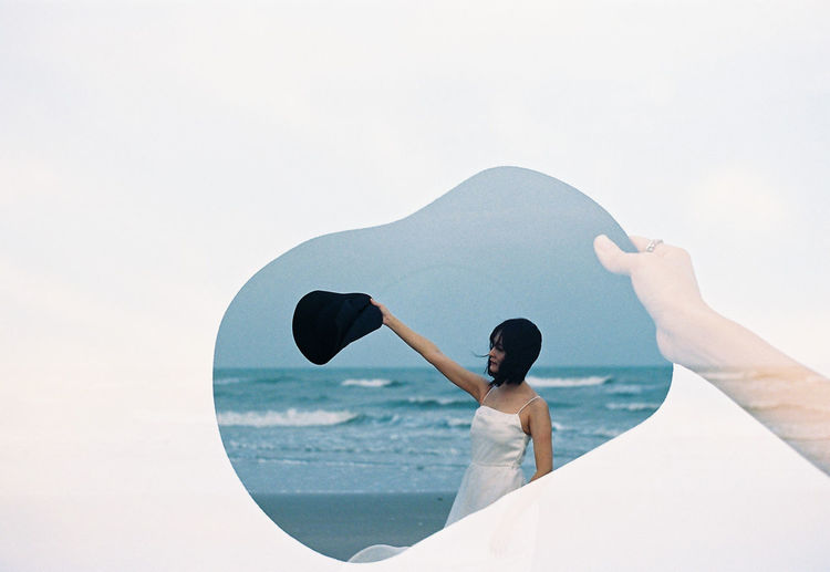 Fantasy image of a beautiful women at the ocean, Techniques for overlapping images with film camera Abstract Adult Alone Background Beach Beautiful Beauty Black Blurred People Caucasian Concept Female Film Camera Girl Grain Happiness Happy Hats Landscape Lifestyle Lonely Looking Love Nature Noise Ocean Outdoor Overlap People person Photo Portrait Relax Sad Sand Sea Sky Solitude Standing Style Summer Travel Freedom Vacation View Vintage Water White Woman Young