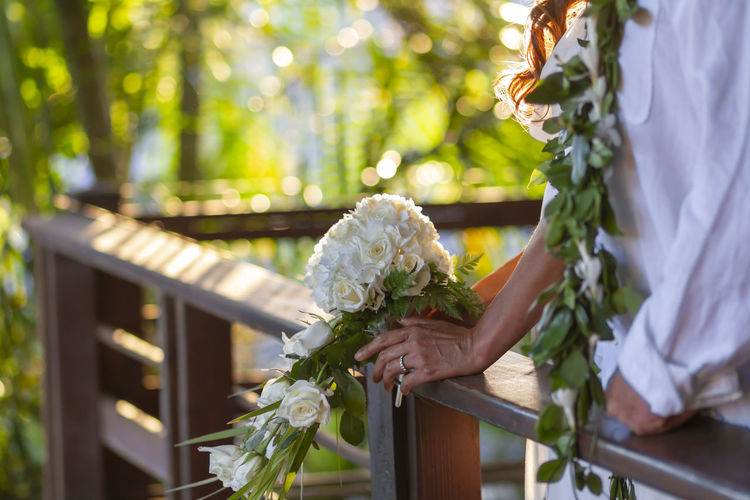 Bride and Groom before the Wedding Hawaii Adult Beauty In Nature Bouquet Bride Celebration Day Event Flower Flower Arrangement Flowering Plant Freshness Leisure Activity Life Events Love Nature Newlywed Outdoors People Plant Positive Emotion Wedding Wedding Ceremony Wedding Dress Women