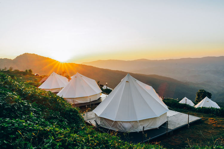 View of tents against sky during sunset
