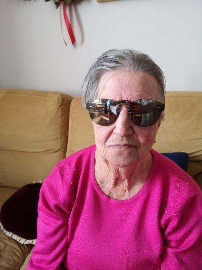 Real style... Huaweip20pro Italy Huaweiphotography EyeEm Photography Style Sunglasses Portrait Gray Hair Eyeglasses  Looking At Camera Sitting Pink Color Senior Adult Headshot Senior Women