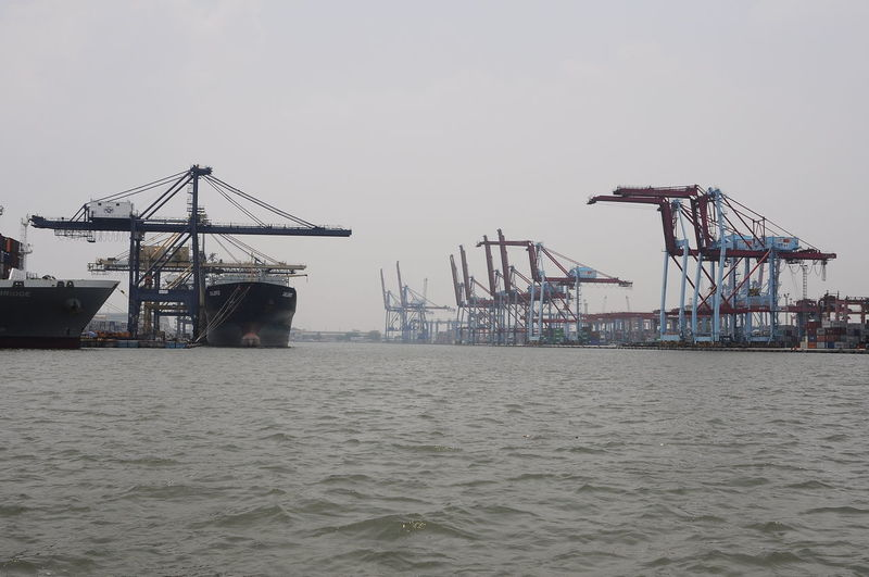 Oil Pump Sea Industry Golf Club Water Crane - Construction Machinery Business Finance And Industry Commercial Dock Beach Sky Shipyard Container Ship Harbor Ship Shipping  Cargo Container Unloading Loading Dock Anchored Industrial Ship