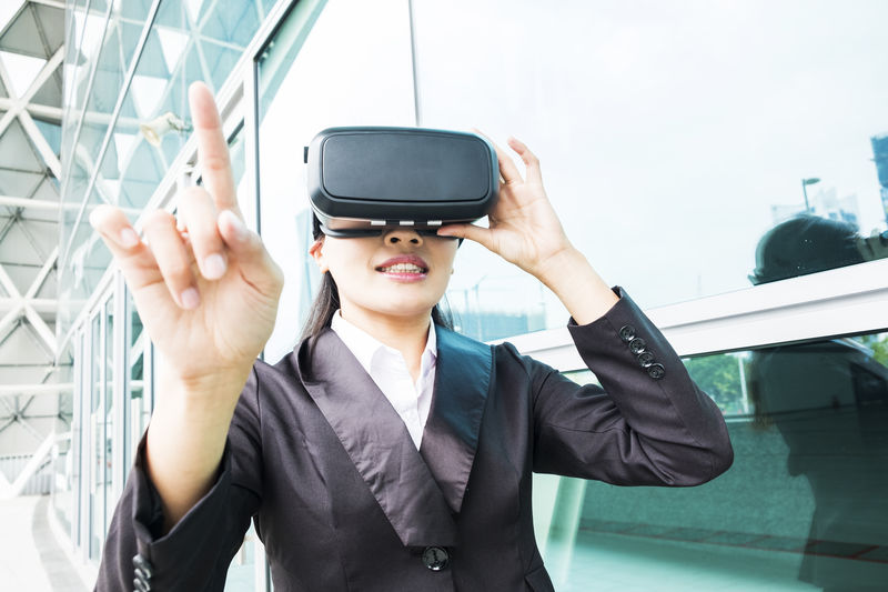Businesswoman gesturing while using virtual reality