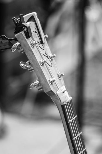 Black & White FUJIFILM X-T10 Arts Culture And Entertainment Backstage Acoustic Black And White Black And White Friday Close-up Concert Day Electric Guitar Focus On Foreground Fretboard Fujifilm Guitar Music Musical Instrument Musical Instrument String No People Outdoors