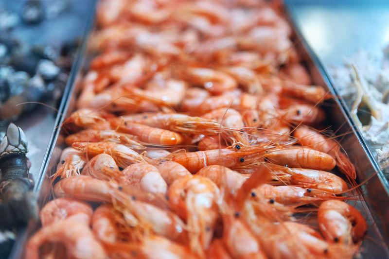 Hot smoked prawns . shrimps on the showcase in the market . pandalus borealis