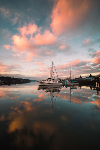 In this moment i knew i needed to sail away for some time. These amazing reflections accompanied by cotton candy skies gave me hope. Water Cloud - Sky Sky Sunset Reflection Waterfront No People Nature Beauty In Nature Transportation Scenics - Nature Tranquility Sea Architecture Tranquil Scene Built Structure Outdoors Orange Color Idyllic Bay PNW Washing Canon Moody Sky Moody