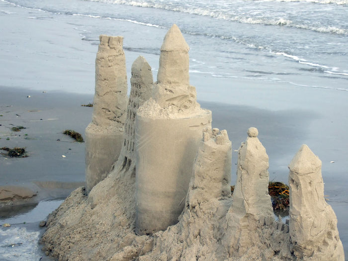 Castle could use a lil lovin Sand Castle Beach Beauty In Nature Day Human Representation Nature Outdoors Sand Sand & Sea Sand Castle Making Sand Castles  Sculpture Sea Water Wave