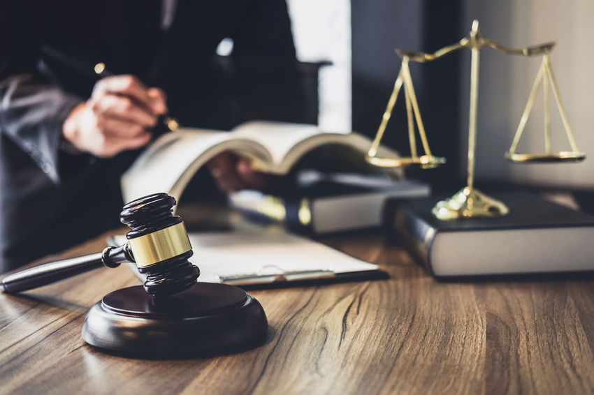 Lawyer Balance Barrister Book Business Person Counselor Courthouse Fairness Gavel Hand Holding Human Hand Indoors  Inheritance Judge Judgement Justice Legal Men One Person Publication Selective Focus Sitting Verdict Wood - Material
