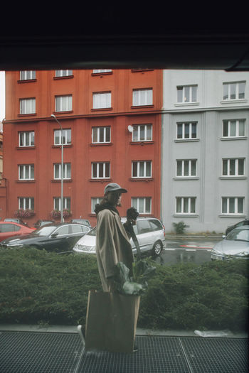 Rear view of man outside building