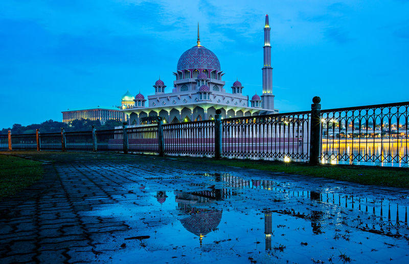 Built Structure Architecture Water Sky Building Exterior Nature Religion Travel Destinations Reflection Dome Tourism Travel Waterfront City Belief Place Of Worship Spirituality No People Outdoors Spire  Reflecting Pool Mosque Putrajaya Putra Mosque