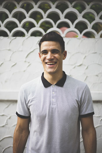 Casual Clothing Focus On Foreground French Front View Handsome Laughing Looking At Camera Model Person Portrait Standing Textures And Surfaces Toothy Smile Waist Up Young Adult