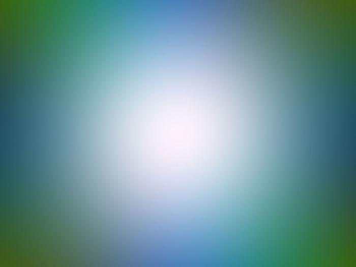 Defocused image of illuminated blue sky