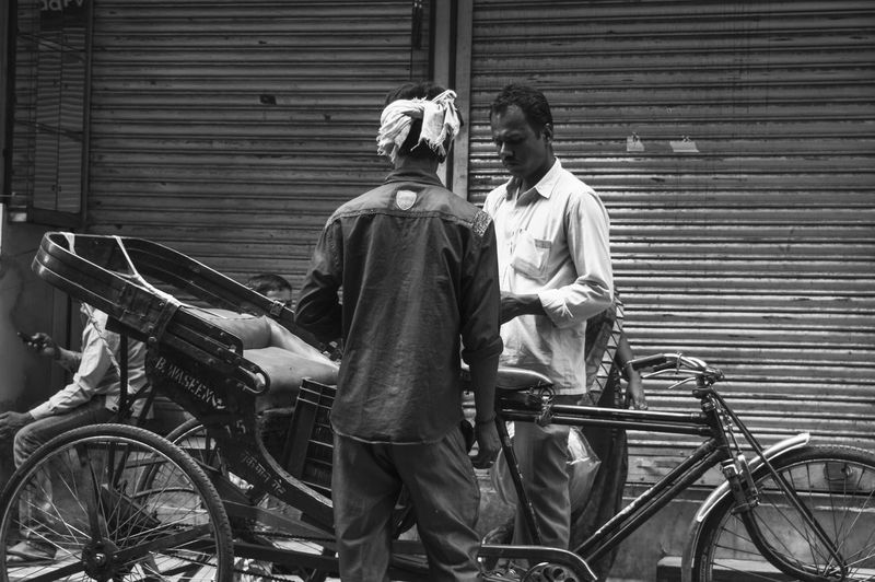 Rear view of people on bicycle