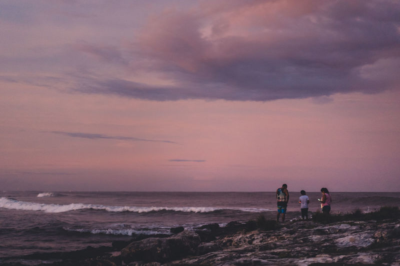 Sea Sky Water Beach Cloud - Sky Beauty In Nature Sunset Horizon Over Water Land Scenics - Nature Horizon Real People Leisure Activity Nature Group Of People People Men Lifestyles Standing Outdoors