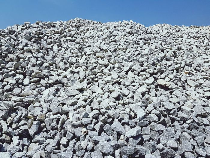 Lime stone stock pile Stone Limestone Rock Calcium Carbonate Material Quarry Mining Industry Industrial Factory Plant Stock Pile Sea Life Rock - Object Sky Close-up Pebble Geology