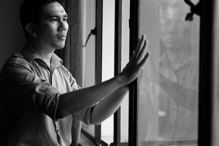 Window One Person Real People Indoors  Curtain Looking Through Window Standing Lifestyles Day Young Adult Close-up Adult People Hand Touching Self Portrait Selfportrait Portrait Indoors  Front View Resist TCPM The Portraitist - 2017 EyeEm Awards