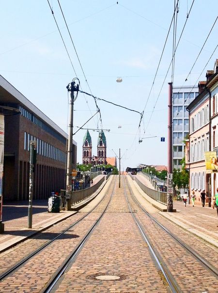 Freiburg Building Exterior Built Structure Architecture Transportation Railroad Track Cable Outdoors City Sky Day Power Line  The Way Forward Rail Transportation Clear Sky Land Vehicle Real People Tram Public Transportation Electricity Pylon