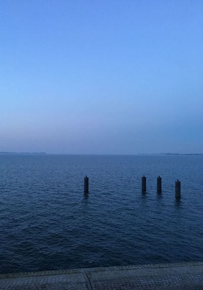 Scenic View Of Baltic Sea Against Blue