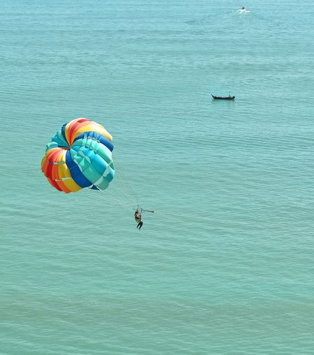 High Angle View Of Parasailing Over Sea On Sunny Day