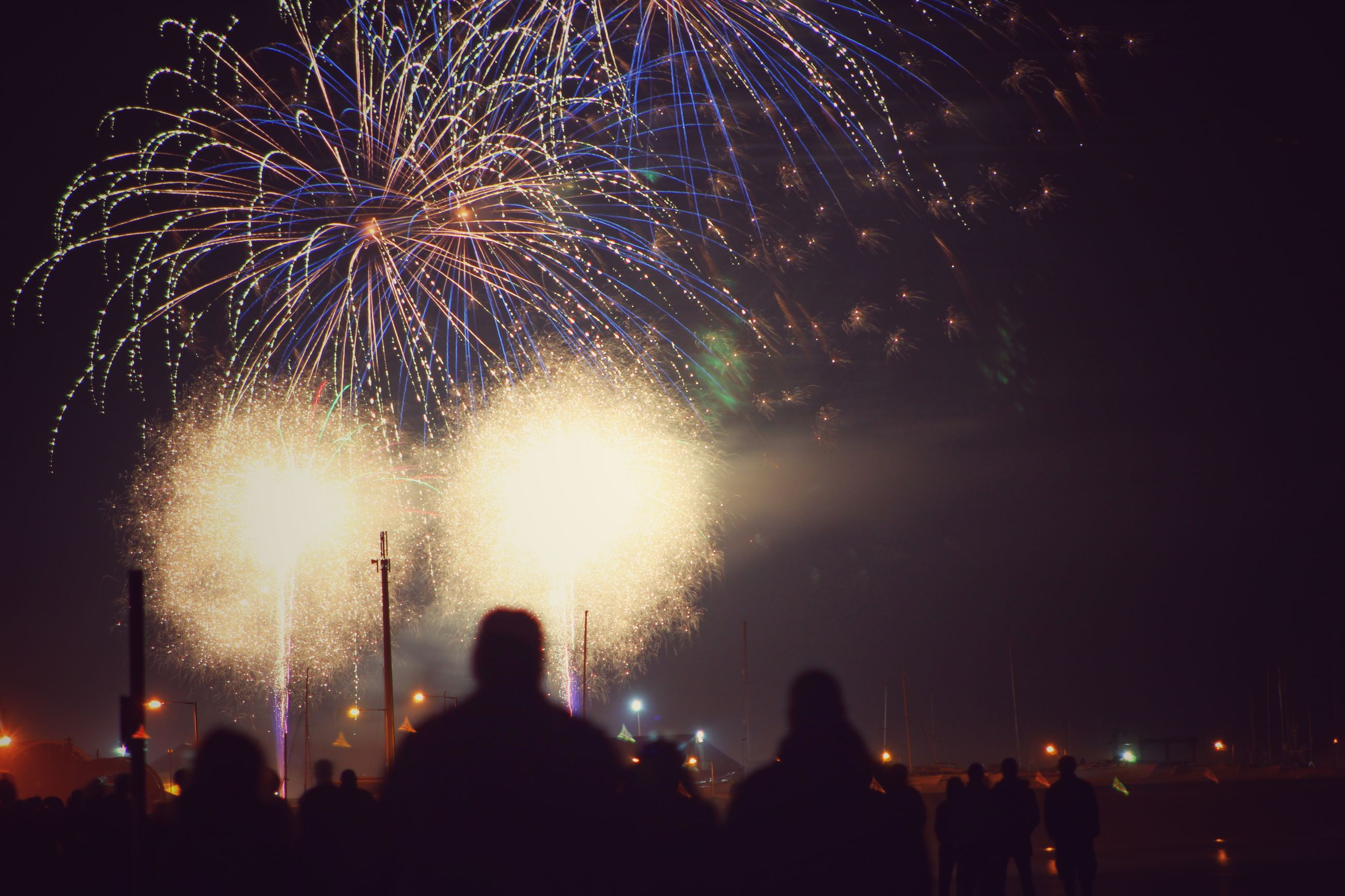 illuminated, night, large group of people, arts culture and entertainment, celebration, event, lifestyles, men, leisure activity, firework display, crowd, person, enjoyment, exploding, firework - man made object, togetherness, sparks, fun, nightlife