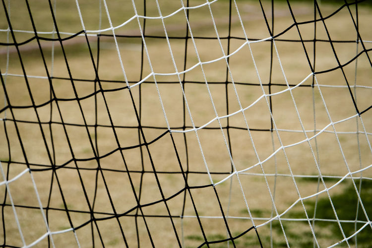 Nets Pattern No People Sport Full Frame Focus On Foreground Backgrounds Net - Sports Equipment Close-up Soccer Field Sports Equipment Soccer Nature Netting Soccer Goal Grass Outdoors Selective Focus Team Sport