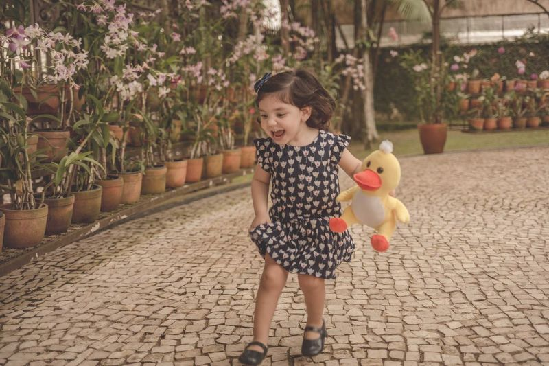 Running Hapiness Magicofchildhood Thechildrenoftheworld Thehonestlens Thesincerestoryteller My_magical_moments Goodmorning EyeEm  Child Childhood Full Length Girls Cute Fun Standing Babyhood Baby Clothing One Baby Girl Only Toy Animal