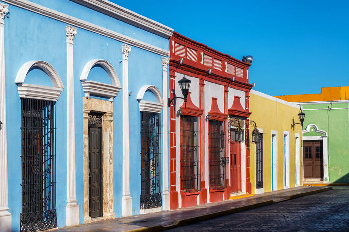 Beautiful colorful colonial buildings in the historic center of Campeche, Mexico America Architecture Building Campeche Caribbean City Cityscape Colonial Downtown Heritage Historic Houses Landmark Latin Mexican Mexico Spanish Square Street Town Unesco UNESCO World Heritage Site Urban Yucatan Mexico Yúcatan