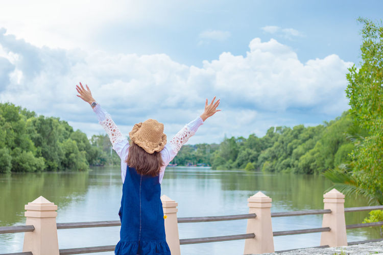 I love nature. Sky Water One Person Hug Hug Nature Standing Lake Day Hairstyle Tree Real People Nature Lifestyles Women River Outdoors Arms Raised Human Arm Cloud - Sky Leisure Activity Asian Women Plant Casual Clothing Limb