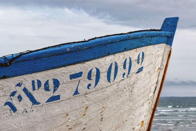 Text on beach against blue sky