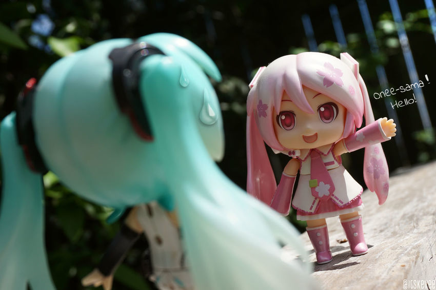 MikuDayo: Onee-sama, hi! Miku: Ughhh Art Close-up Focus On Foreground Outdoors Pink Color Selective Focus Anime Toy ねんどろいど Outdoor Photography Nendoroid Hatsune Miku 初音ミク Figurine  Creativity Toyphotography Green Color