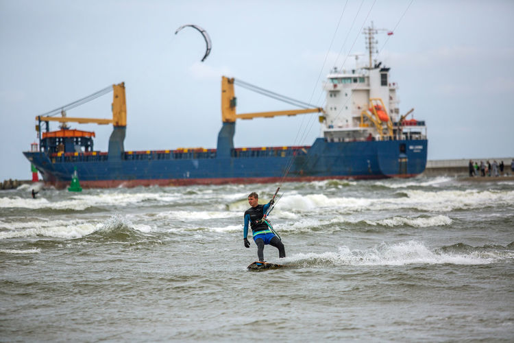Baltic Baltic Sea Adventure Aquatic Sport Extreme Sports Horizon Over Water Kiteboarding Land Leisure Activity Lifestyles Men Motion Nature One Person Outdoors Real People Sea Skill  Sky Sport Surfing Transportation Water Wave