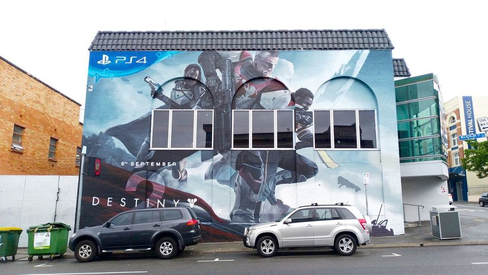 I love the idea of this ads. City Ads Architecture Building Exterior Built Structure Car City Day Human Representation Land Vehicle Mode Of Transport No People Outdoors Painting Playstation Sky Street Transportation