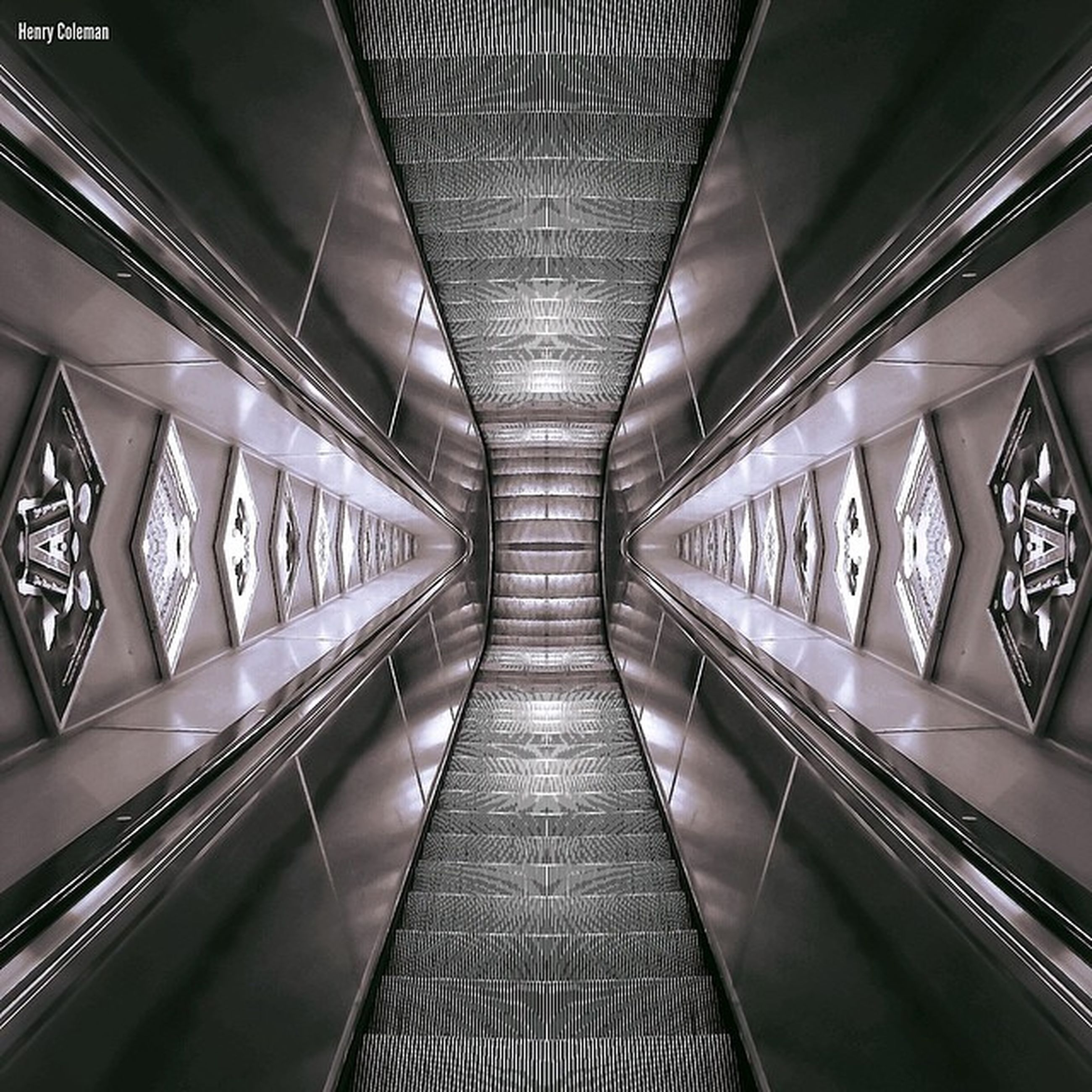 indoors, ceiling, transportation, the way forward, diminishing perspective, architecture, built structure, railing, low angle view, empty, modern, vanishing point, absence, interior, no people, connection, pattern, high angle view, in a row, metal