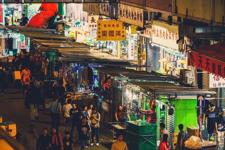 Retail  Market Group Of People Market Stall City Architecture Large Group Of People Crowd Built Structure Building Exterior Real People Street Night Illuminated Shopping Choice For Sale Street Market Business Variation