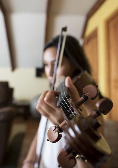 Close-up of woman playing violin