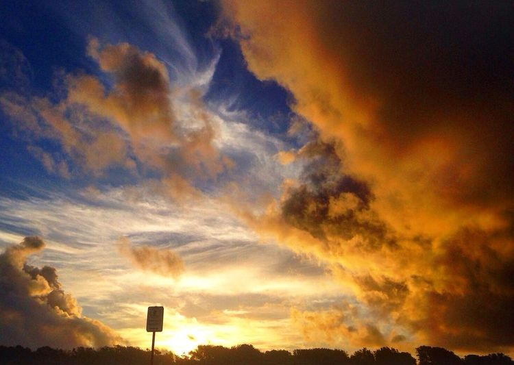 Low angle view of cloudy sky at sunset